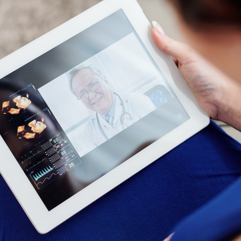 Pregnant woman having telemedicine session with her gynecologist